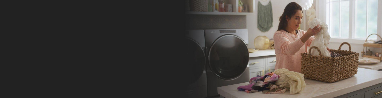 Woman sorting laundry