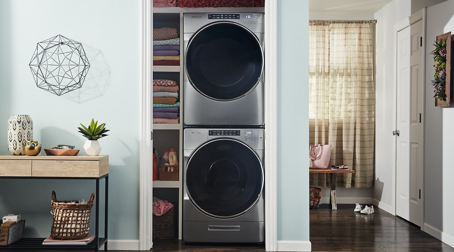 Stacked washer and dryer in a closet