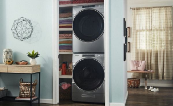 Stacked washer and dryer units inside a closet