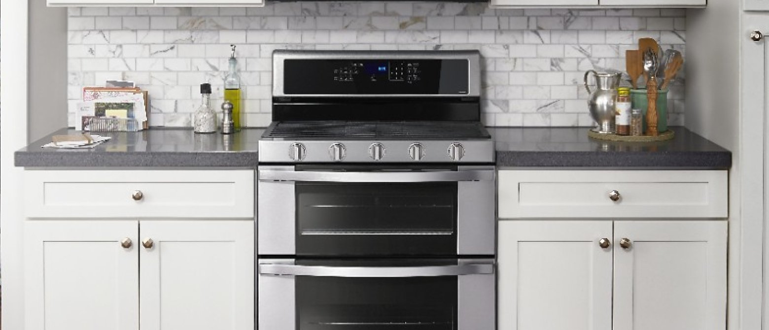 Double oven in between kitchen cabinets