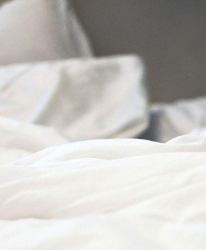 A closeup of a white comforter