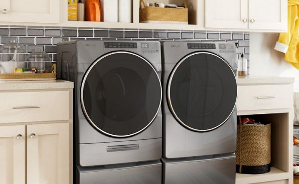 Front load chrome washer and dryer in a laundry room