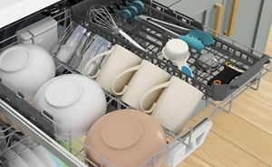 Bowls, mugs and utensils loaded in the 3rd rack of a dishwasher