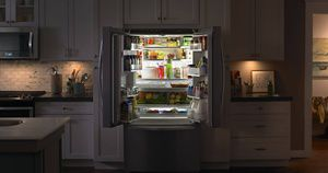 Open Whirlpool® Refrigerator in a kitchen