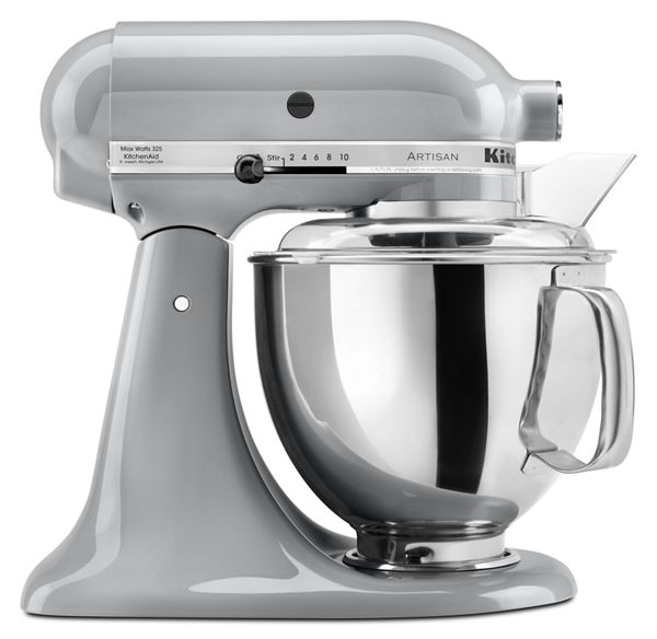 Make up to 9 dozen cookies in a single batch with this refurbished KitchenAid® Artisan® Series 5 Quart Tilt-Head Stand Mixer. This mixer also features 10 speeds to thoroughly mix, knead and whip ingredients quickly and easily and is available in a variety of colors to perfectly match your kitchen design or personality. For even more versatility, use the power hub to turn your stand mixer into a culinary center with over 10 optional hub powered attachments, from food grinders to pasta makers and more. Accessories included: beater, dough hook and wire whisk.