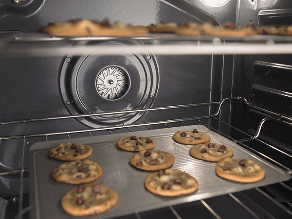 A pan of cookies in the oven