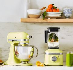 A bright counter with a Kyoto Glow KitchenAid® Artisan® Series Stand Mixer and K400 Variable Blender.